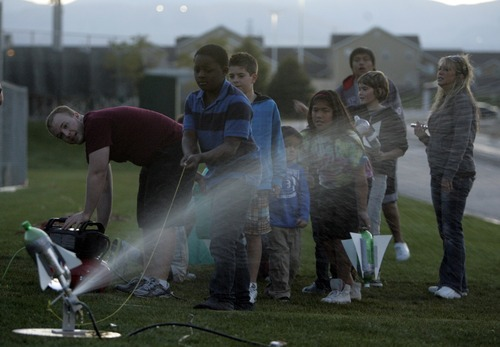 Kim Raff | The Salt Lake Tribune (middle) Dalton Nell launches a water rocket during the Copper Hills High Math, Engineering and Science Association's annual