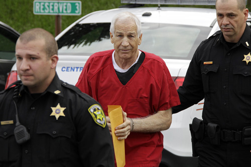 Former Penn State University assistant football coach Jerry Sandusky, center,  arrives for sentencing at the Centre County Courthouse in Bellefonte, Pa., Tuesday, Oct. 9, 2012. Tuesday, Oct. 9, 2012. Sandusky was convicted of sexually abusing 10 boys in a scandal that rocked the university and brought down Hall of Fame coach Joe Paterno. (AP Photo/Gene J. Puskar)