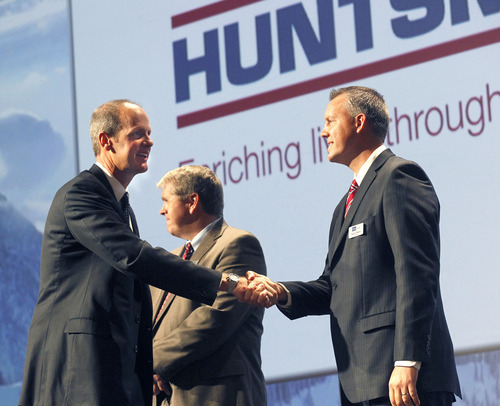 Al Hartmann  |  The Salt Lake Tribune Huntsman Corp. executive John Heskett, left, accepts the Utah Top Revenue award from Jason Watson of MountainWest Capital Network at a ceremony Tuesday at the Grand America Hotel in Salt Lake City.