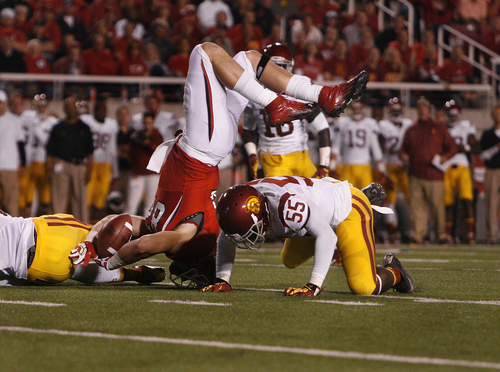 Scott Sommerdorf  |  The Salt Lake Tribune              Utah Utes tight end Jake Murphy (82) lands awkwardly on his head after a first-half catch against USC on Oct. 4, 2012. He was uninjured.