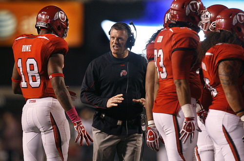 Scott Sommerdorf  |  The Salt Lake Tribune              Utah head coach Kyle Whittingham speaks to Utah Utes defensive back Eric Rowe (18) during a third-quarter timeout against USC on Oct. 4, 2012.