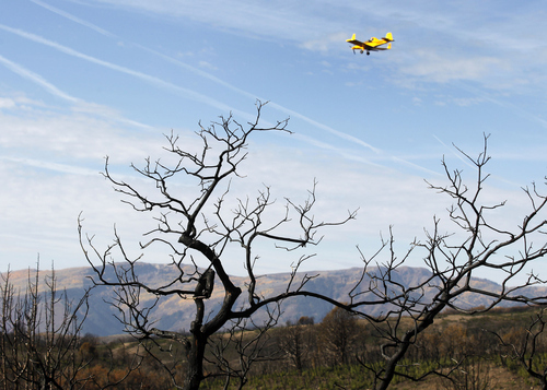 Al Hartmann  |  The Salt Lake Tribune Native and non-native seed mixture is spread by plane across  burned areas during this Summer's  Wood Hollow Fire near Mount Pleasant.  The seeds will help with ersosion problems and provide food for wildlife as the ground heals.