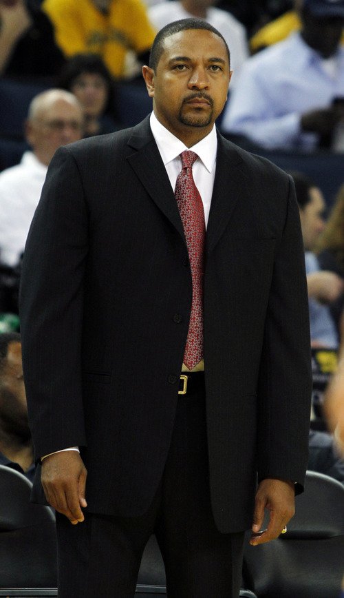 Golden State Warriors head coach Mark Jackson watches during the first half of a preseason NBA basketball game against the Utah Jazz in Oakland, Calif., Monday, Oct. 8, 2012. (AP Photo/George Nikitin)