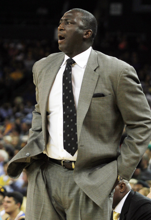 Utah Jazz head coach Tyrone Corbin reacts during the first half of a preseason NBA basketball game against the Golden State Warriors in Oakland, Calif., Monday, Oct. 8, 2012. (AP Photo/George Nikitin)