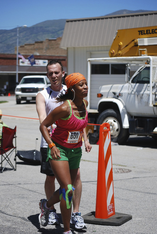Mia Love and her husband, Jason, at an exchange during the Ragnar Wasatch Back Relay Race. Courtesy Love family.