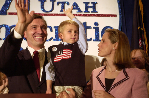 Tribune file photo Rep. Jim Matheson, accompanied by his wife Amy, holds his then-5-year-old son William as he waves to a room full of supporters after giving  his victory speech on Election Night 2004.