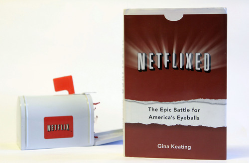 Gina Keating's book Netflixed: The Epic Battle for America's Eyeballs is photographed in San Francisco, Tuesday, Oct. 9, 2012. The book, set to go on sale Thursday, Oct. 11, 2012, tries to debunk a widely told tale about the company's origins and paints a polarizing portrait of its star CEO Reed Hastings. (AP Photo/Jeff Chiu)