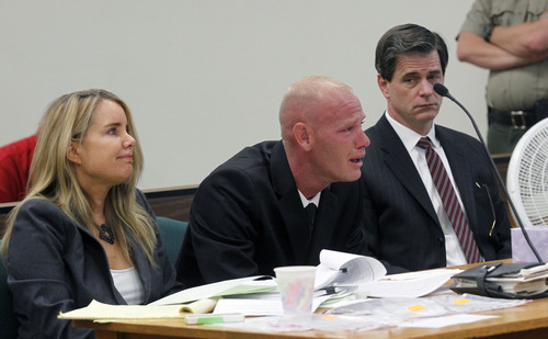 Al Hartmann  |  The Salt Lake Tribune Eric Charlton sobs during his preliminary hearing in Judge James Brady's Fourth District Court in Nephi Wednesday September 19.  He is comforted by his defense lawyers Susanne Gustin, left, and Andy Deiss, right.     He is charged with one count of manslaughter, a second-degree felony; reckless endangerment, a class A misdemeanor; and carrying a dangerous weapon under the influence of alcohol/drugs, a class B misdemeanor, for the accidental shooting death of his 17-year-old brother, Cameron Bryce Charlton, May 28.