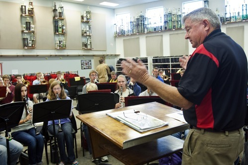 Chris Detrick  |  The Salt Lake Tribune John Miller conducts members of the Wind Symphony during a rehearsal at American Fork High School Wednesday October 10, 2012. The symphony, along with the University of Utah Wind Ensemble, will perform a special concert in honor of Heather Christensen on Oct. 23 on the university's campus.