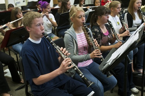 Chris Detrick  |  The Salt Lake Tribune Jason Cannon and Emma Petersen and other members of the Wind Symphony perform during a rehearsal at American Fork High School Wednesday Oct. 10, 2012. The symphony, along with the University of Utah Wind Ensemble, will perform a special concert in honor of Heather Christensen on Oct. 23 on the university's campus.