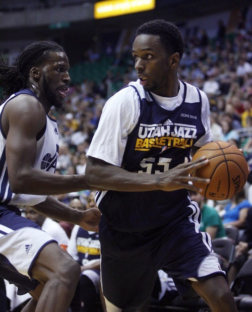 Kim Raff | The Salt Lake Tribune Kevin Murphy, right, looks to pass as DeMarre Carroll defends during the Jazz Scrimmage at EnergySolutions Arena in Salt Lake City on Oct. 6, 2012.