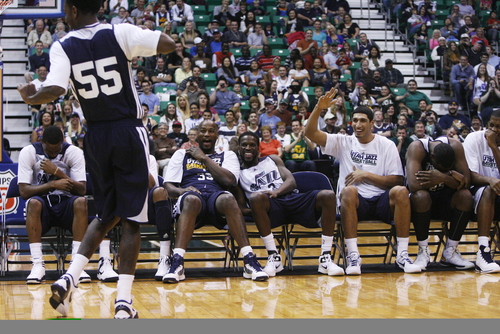 Kim Raff | The Salt Lake Tribune Kevin Murphy's teammates cheer him on as he dances during a Jazz Scrimmage at EnergySolutions Arena in Salt Lake City on Oct. 6, 2012.