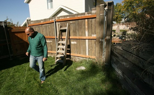 Leah Hogsten  |  The Salt Lake Tribune Naveen Pammi walks away from the spot where he found his dog Rusty, who died within minutes from inhaling a herbicide that was being sprayed at the neighbor's home in North Salt Lake. The death of the golden retriever in August has prompted the Pammis to speak up about the dangers of pesticides and support another efforts to get Utah to adopt a neighbor notification law