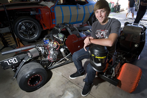 Scott Sommerdorf  |  The Salt Lake Tribune              Josh Jones, a senior at Juan Diego High School and a Junior drag racer at Rocky Mountain Raceways sits next to the drag racer he will drive when he competes in Memphis at the IHRA World Finals Oct 12-14. There are only 16 kids nationwide that were selected. Tim & Jill Jones of West Jordan and their 3 sons Josh, 17, Jake, 15, and Jared, 12, race at Rocky Mountain Raceways.