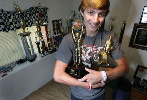 Scott Sommerdorf  |  The Salt Lake Tribune              Josh Jones, holds his most prized trophies while others are displayed in his room, Sunday, October 7, 2012. Jones, 17, was selected to travel to Memphis to race at the IHRA World Finals Oct 12-14. There are only 16 kids nationwide that were selected.