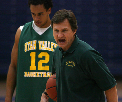 UVSC basketball coach Dick Hunsaker yells instructions to his team during practice at Orem High School Nov. 3, 2006.. Griffin/photo