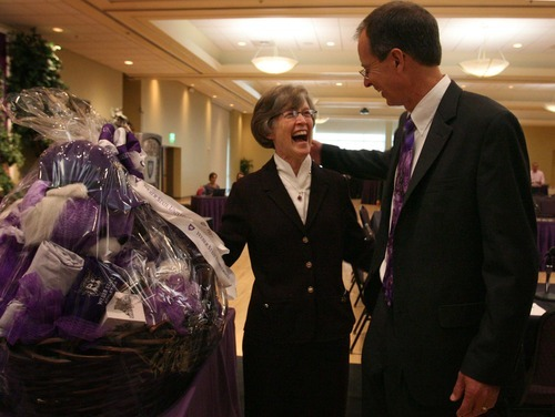 Leah Hogsten  |  The Salt Lake Tribune Charles Wight shares a laugh with Ann Millner, who served as president for 10 years as Millner presents him with a Weber State University gift basket. Charles A.