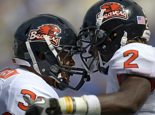 Oregon State Beavers wide receiver Markus Wheaton, right, celebrates his touchdown with teammate fullback Tyler Anderson during the first half of their NCAA college football game against UCLA, Saturday, Sept. 22, 2012, in Pasadena, Calif. (AP Photo/Mark J. Terrill)