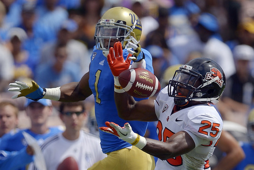 Oregon State safety Ryan Murphy, right, tries for an interception but can't hold on to a pass intended for UCLA wide receiver Shaquelle Evans during the first half of their NCAA college football game, Saturday, Sept. 22, 2012, in Pasadena, Calif. AP Photo/Mark J. Terrill)