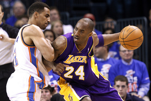 Los Angeles Lakers guard Kobe Bryant (24) drives around Oklahoma City Thunder guard Thabo Sefolosha, left, in the first quarter of Game 5 in their NBA basketball Western Conference semifinal playoff series, Monday, May 21, 2012, in Oklahoma City. (AP Photo/Sue Ogrocki)