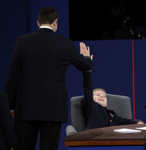 Republican vice presidential nominee Paul Ryan of Wisconsin high fives his son Charlie after the vice presidential debate at Centre College, Thursday, Oct. 11, 2012, in Danville, Ky. (AP Photo/Charlie Neibergall)