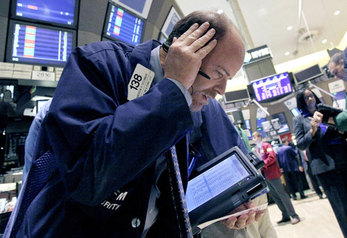 FILE - In this Oct. 9, 2012, file photo, trader Andrew O'Connor works on the floor of the New York Stock Exchange. After three straight days of losses for major stock indexes, investors appeared to be looking for bargains Thursday. (AP Photo/Richard Drew, File)