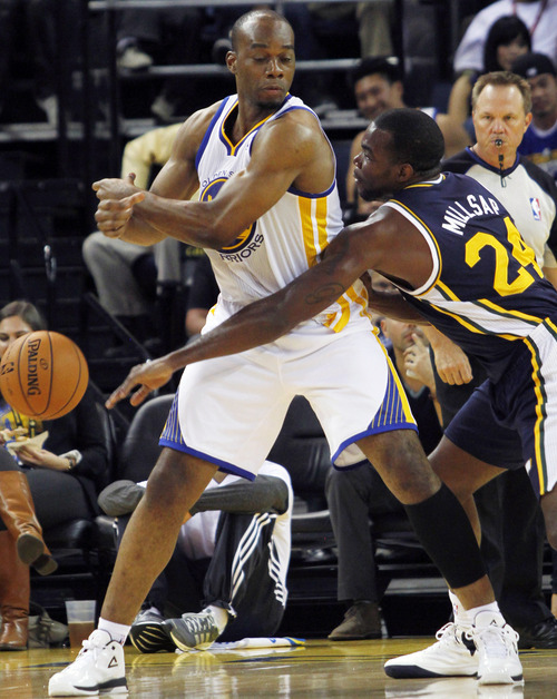 Utah Jazz's Paul Millsap, right, knocks the ball away from Golden State Warriors' Carl Landry during the second half of a preseason NBA basketball game in Oakland, Calif., Monday, Oct. 8, 2012. (AP Photo/George Nikitin)