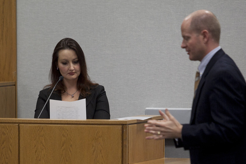 Mark Johnston | Daily Herald  Witness Gypsy Willis reviews a document handed to her by prosecutor Chad Grunander, right, during a preliminary hearing in the case of Martin MacNeill at the Fourth District Court in Provo Wednesday, Oct. 10, 2012.