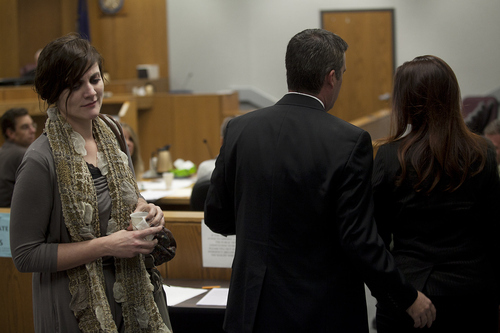 Mark Johnston | Daily Herald   Rachel MacNeill, left, daughter of defendant Martin MacNeill, passes witness Gypsy Willis, right, as she entered the courtroom during a preliminary hearing at the Fourth District Court in Provo Wednesday, Oct. 10, 2012.