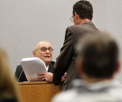 Al Hartmann  |  The Salt Lake Tribune Independent medical examiner Dr Joshua Perper from Florida is questioned by defense attorney Randy Spencer during Martin MacNeill's preleminary trial in Judge Sam McVey's Fourth District Court in Provo Wednesday October 10.