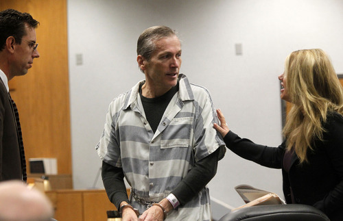 Al Hartmann  |  The Salt Lake Tribune Martin MacNeill,  a doctor accused of murdering his wife speaks to his defense lawyers Randy Spencer, left, and Susanne Gustin in Judge Sam McVey's Fourth District Court in Provo Wednesday October 10 during his preliminary hearing.