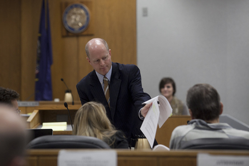 Mark Johnston | Daily Herald  Prosecutor Chad Grunander shows a document to defense attorney Susanne Gustin before handing it to witness Rachel MacNeill during a preliminary hearing in the case of Martin MacNeill at the Fourth District Court in Provo Wednesday, Oct. 10, 2012.