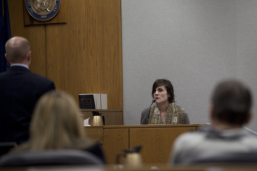 Mark Johnston | Daily Herald  Rachel MacNeill, daughter of defendant Martin MacNeill, speaks to prosecutor Chad Grunander, left, during a preliminary hearing at the Fourth District Court in Provo Wednesday, Oct. 10, 2012.