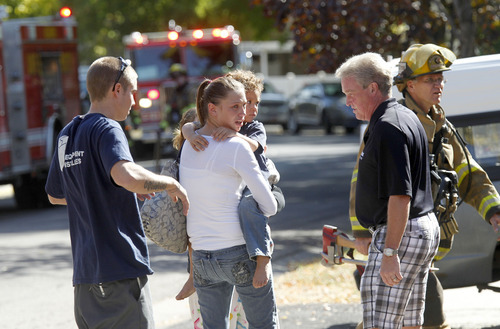Al Hartmann  |  The Salt Lake Tribune Displaced neighbors wait as Unified Fire Authority responds to a two-alarm duplex fire at 804 E. Red Maple Road (3700 South) Thursday October 11.