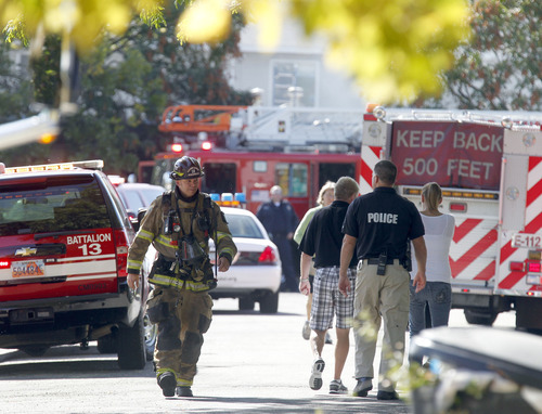 Al Hartmann  |  The Salt Lake Tribune Unified Fire Authority responds to a two-alarm duplex fire at 804 E. Red Maple Road (3700 South) Thursday October 11.