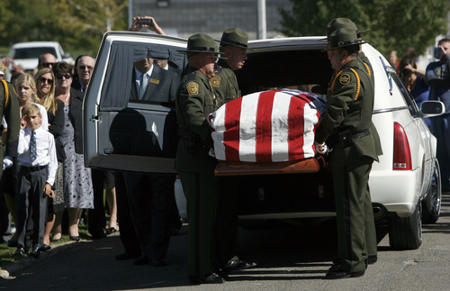 Francisco Kjolseth  |  The Salt Lake Tribune U.S. Customs and Border Patrol agents move the casket containing border patrol agent Nicholas Ivie after arriving at the Spanish Fork Cemetery surrounded by friends, family, and numerous service agencies on Thursday, October 11, 2012.