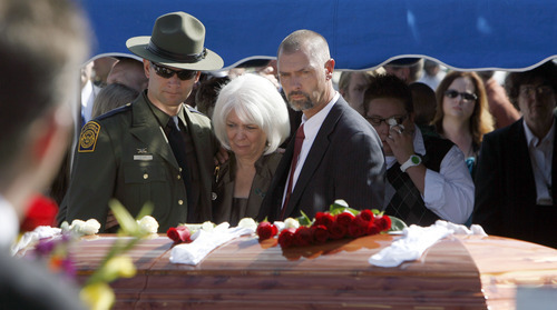 Francisco Kjolseth  |  The Salt Lake Tribune Joel Ivie, left, a border patrol agent, along with his mother Cheryl and brother Chris, pay their repects to their brother and son Nicholas Ivie at Spanish Fork Cemetery surrounded by numerous service agencies and friend and family on Thursday, October 11, 2012. Border patrol agent Ivie was killed on Oct. 2 near the Arizona-Mexico border in what investigators deemed was a friendly fire accidental shooting.