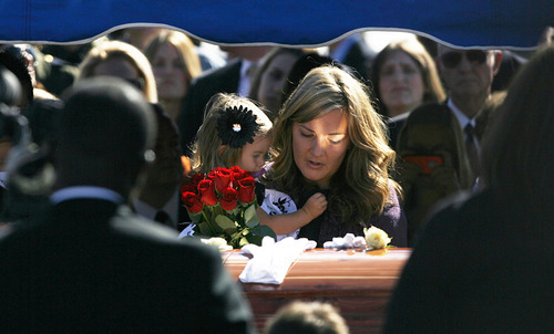 Francisco Kjolseth  |  The Salt Lake Tribune Christy Ivie holds her daughter Presley, 22-months, as she stands by the casket of her husband, border patrol agent Nicholas Ivie, a Provo native, during funeral services at Spanish Fork cemetery on Thursday October 11, 2012. Ivie was killed on Oct. 2 near the Arizona-Mexico border in what investigators deemed was a friendly fire accidental shooting.