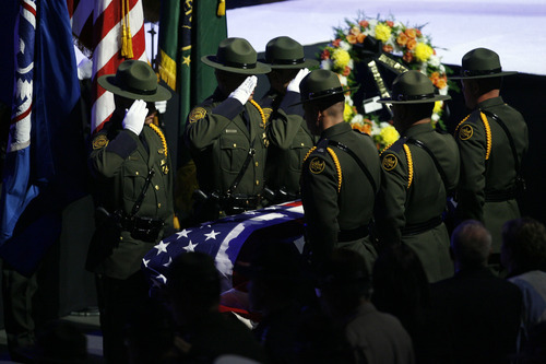 Francisco Kjolseth  |  The Salt Lake Tribune Border patrol agents salute the casket of agent Nicholas Ivie, during Ivie's funeral at the UCCU Center at Utah Valley University in Orem on Thursday, October 11, 2012. Agent Ivie, a Provo, Utah native, was killed in a shooting at the Arizona-Mexico border October 2nd.