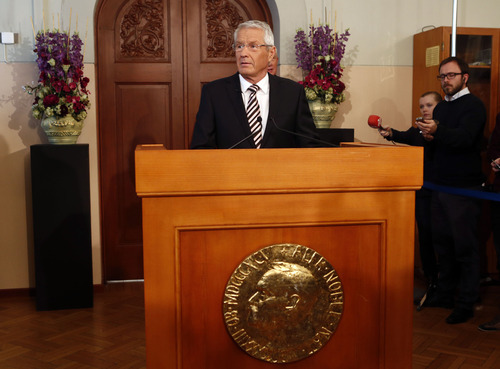 Norwegian Nobel Committee Chairman Thorbjoern Jagland, centre, announces the European Union as the recipients of the 2012 Nobel Peace prize in Oslo, Norway, Friday, Oct. 12, 2012. The European Union has been awarded the Nobel Peace Prize for its efforts to promote peace and democracy in Europe, in the midst of the union's biggest crisis since its creation in the 1950s. The Norwegian prize committee said the EU received the award for six decades of contributions