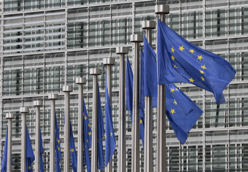 FILE - In this Monday, May 9, 2011 file photo, EU flags fly at the European Commission headquarters in Brussels. The European Union has won the Nobel Peace Prize, it has been announced on Friday, Oct. 12, 2012.   (AP Photo/Yves Logghe, File)