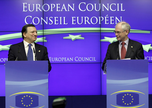 FILE - In this Friday, Dec. 9, 2011 file photo European Council President Herman Van Rompuy, right, and European Commission President Jose Manuel Barroso participate in a media conference at an EU summit in Brussels. The European Union was awarded on Friday Oct. 12, 2012 the Nobel Peace Prize for its efforts to promote peace and democracy in Europe, in the midst of the union's biggest crisis since its creation in the 1950s. The Norwegian prize committee said the EU received the award for six decades of contributions