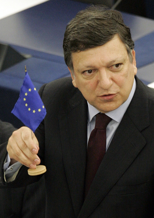 FIle- In this Wednesday July 15, 2009 file photo, President of the European Commission Jose Manuel Barroso shows the European flag during a debate at the European Parliament. The European Union has won the Nobel Peace Prize, it has been announced on Friday, Oct. 12, 2012. (AP Photo/Lionel Cironneau, File)