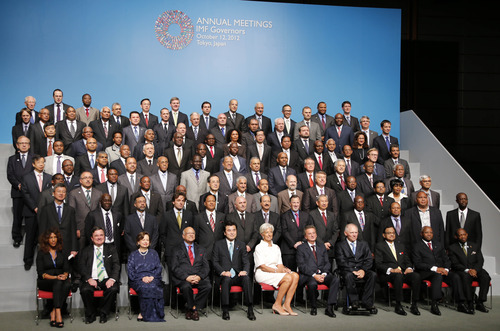 International Monetary Fund Managing Director Christine Lagarde, foreground center, accompanied by Japanese Finance Minister Koriki Jojima, fifth from left, poses with IMF governors for a group photo during the governors family photo session at the annual meetings of the IMF and World Bank Group in Tokyo Friday, Oct. 12, 2012.  (AP Photo/Koji Sasahara)