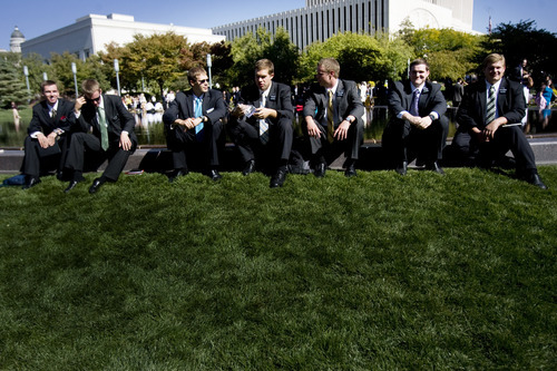 Kim Raff  |  The Salt Lake Tribune LDS missionaries sit by the reflecting pool at Temple Square during the 182nd Semiannual General Conference of the LDS Church in Salt Lake City on Sunday, October 7, 2012.