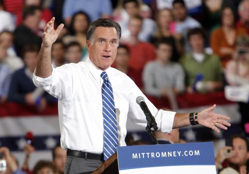 Republican presidential candidate, former Massachusetts Gov. Mitt Romney speaks during a campaign rally at the U.S. Cellular Center on Thursday, Oct. 11, 2012, in Asheville, N.C. (AP Photo/Matt Rose)