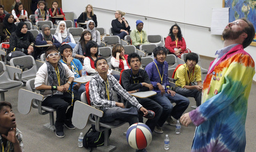 Al Hartmann     The Salt Lake Tribune High school students watch an experiment Friday during a physics workshop given by University of Utah lecture demonstration specialist Adam Beehler, right, during the 2nd annual Refugee Youth Conference that brought together more than 200 refugee students from Granite, Canyons and Salt Lake school districts to learn about the importance of education, particularly higher education.