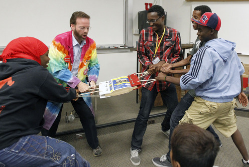 Al Hartmann     The Salt Lake Tribune High school students try to rip apart a phone book in a tug-of-war during a physics workshop Friday given by University of Utah lecture demonstration specialist Adam Beehler during the 2nd annual Refugee Youth Conference that brought together more than 200 refugee students from Granite, Canyons and Salt Lake school districts to learn about the importance of education, particularly higher education. The team of three girls and three boys couldn't tear the book.