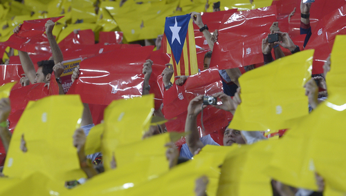 Barcelona soccer fans hold up 'Estelada', center, the Catalan independence flag, amongst color cards forming the red-and-yellow stripes of Catalonia's