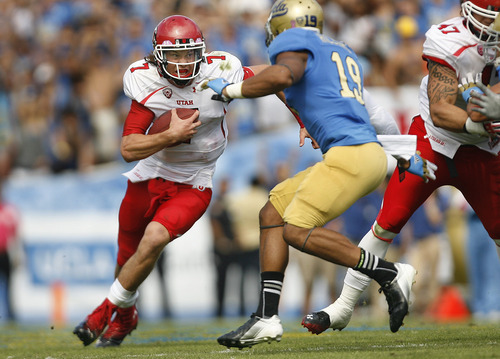 Scott Sommerdorf     The Salt Lake Tribune              Utah Utes quarterback Travis Wilson (7) runs the ball against UCLA Bruins safety Dalton Hilliard (19) during second half play. UCLA defeated Utah 21-14 in Pasadena, Saturday, October 13, 2012.